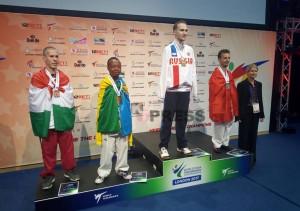 Jean-de-la-Croix-Nikwigize-on-the-podium-as-he-won-the-bronze-medal-at-the-World-Para-Taekwondo-Championship-in-London-1024x720